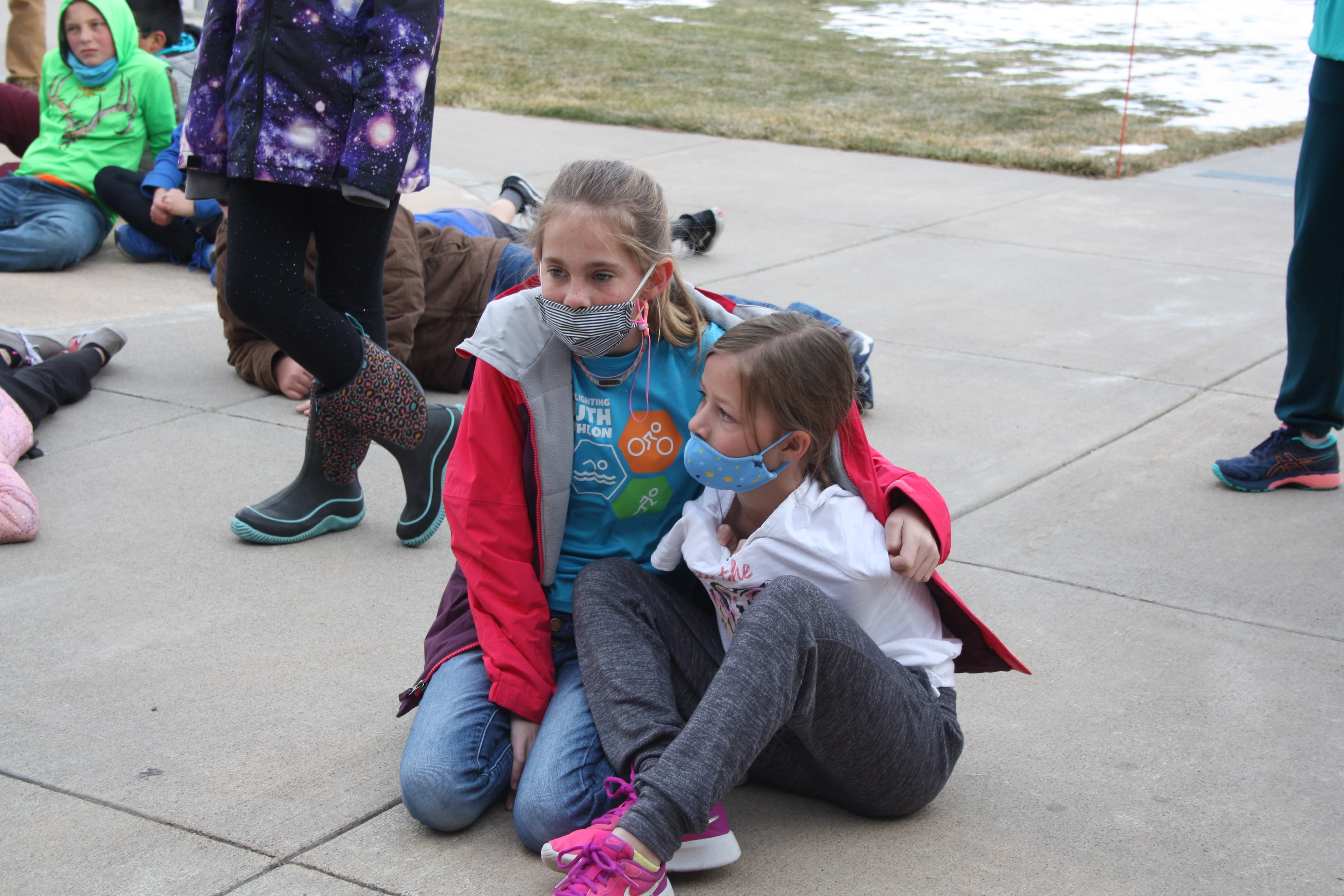 Two students sitting during the turkey trot