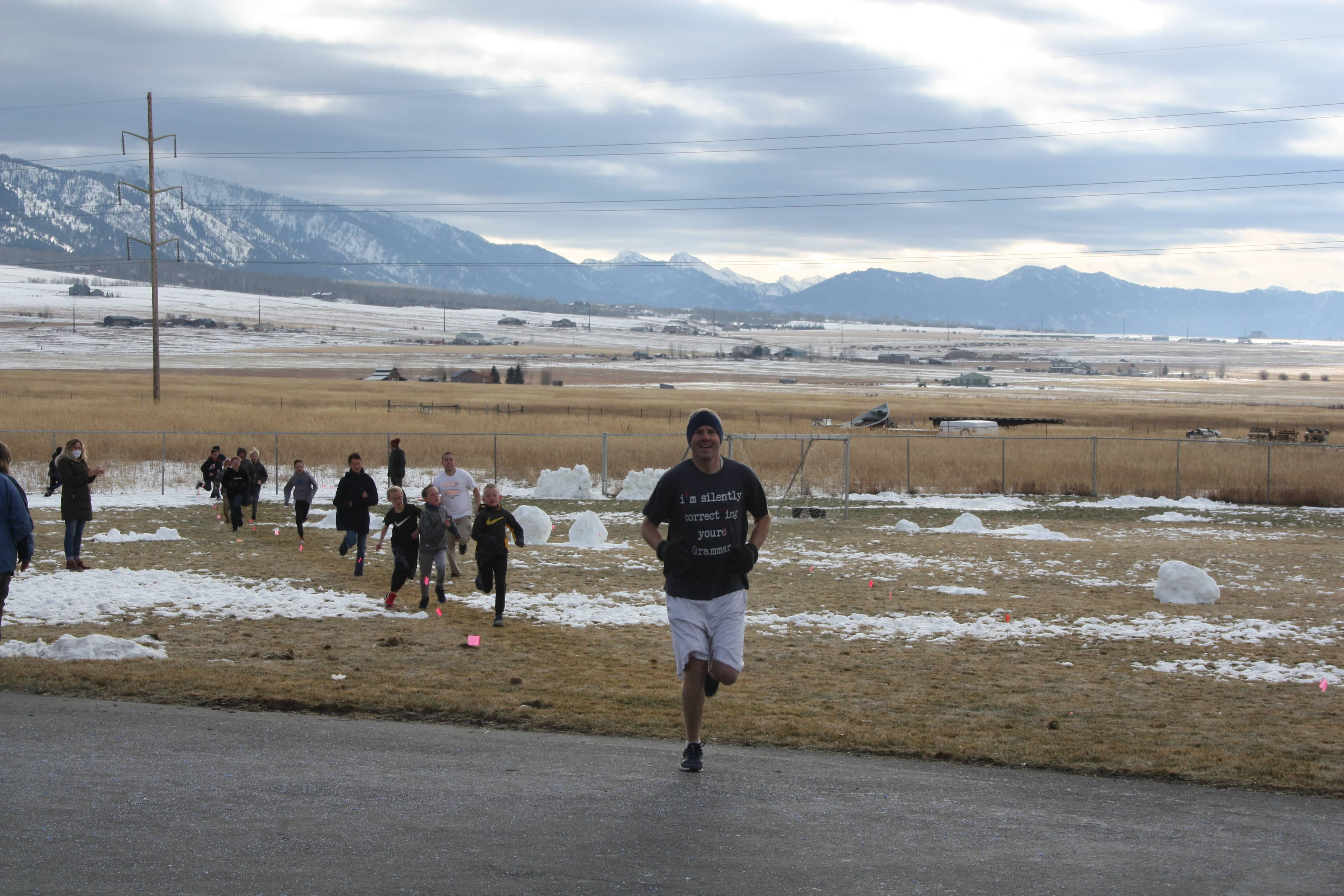Student and staff running to the finish line