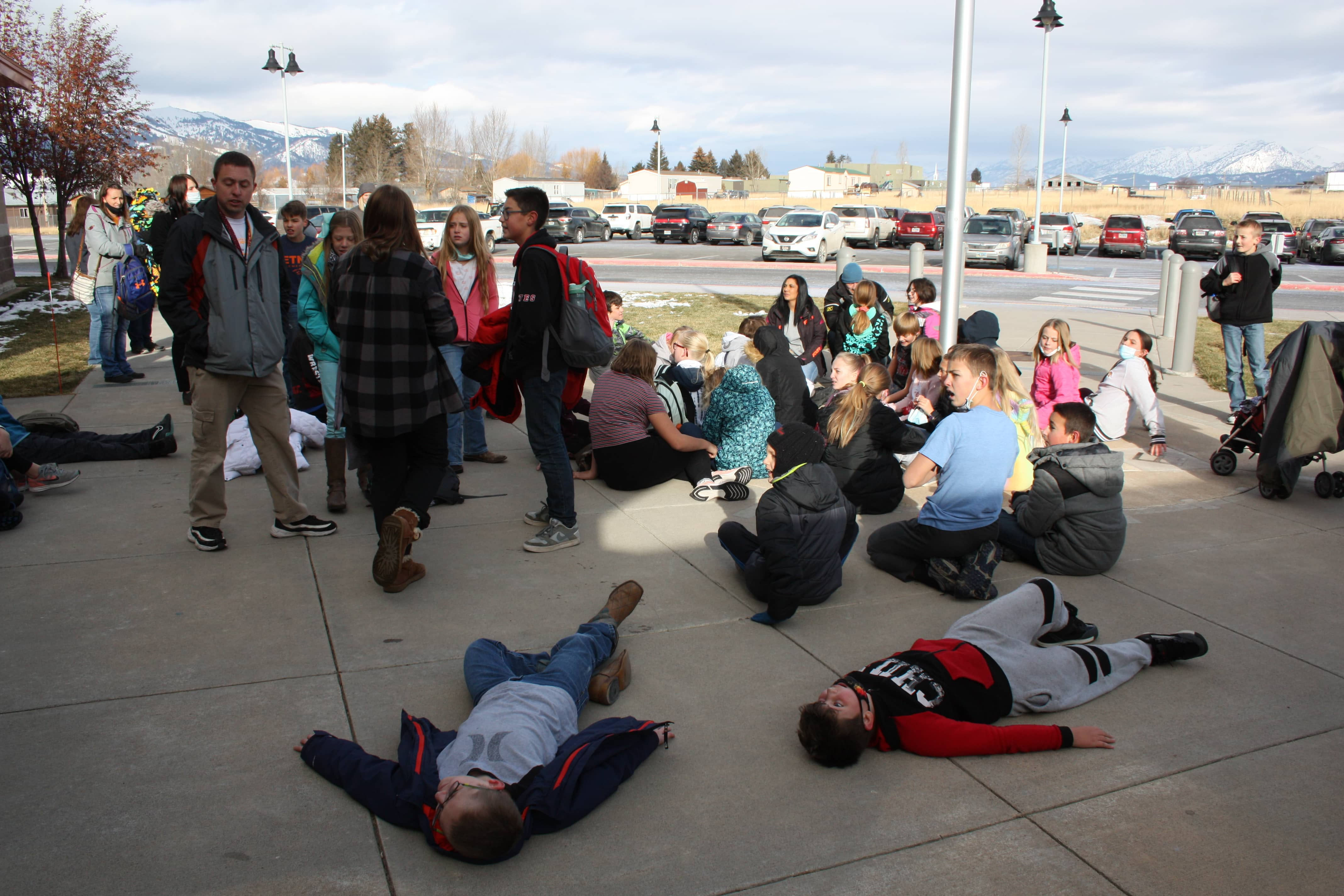 Students laying on the concrete after their race
